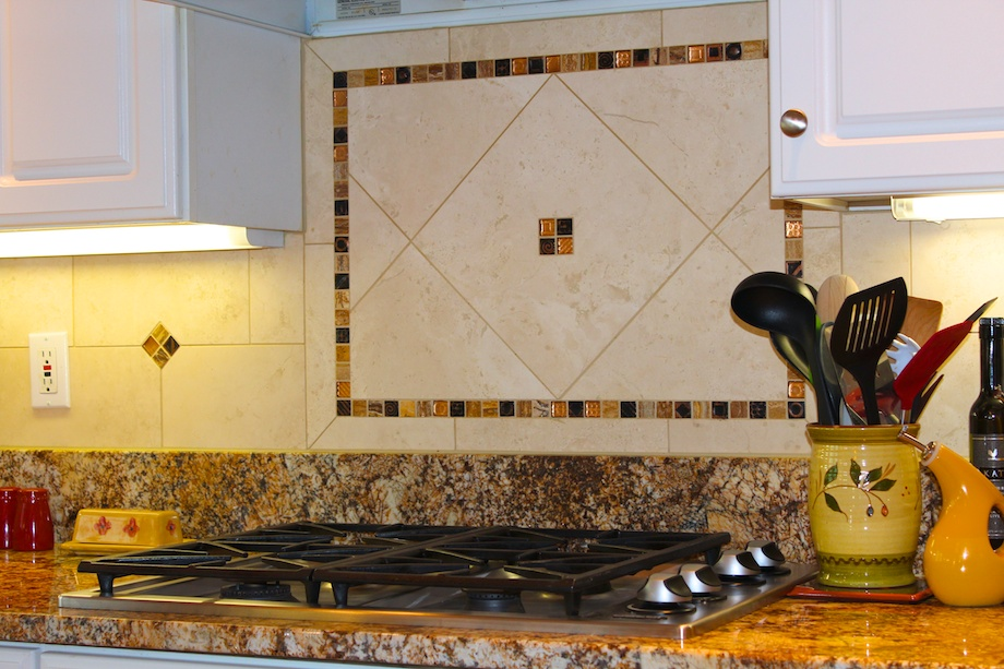 A travertine backsplash with glass accents raised this kitchen's design to a new level.