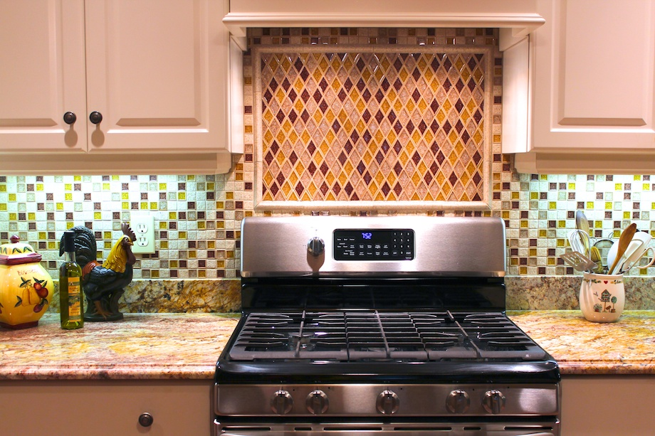 Client's Request: A Wow Backsplash - Teal laminate countertops were replaced with granite.  Everything else in this kitchen is white, so the busyness of two types of backsplashes and the pattern in the granite do not overwhelm.