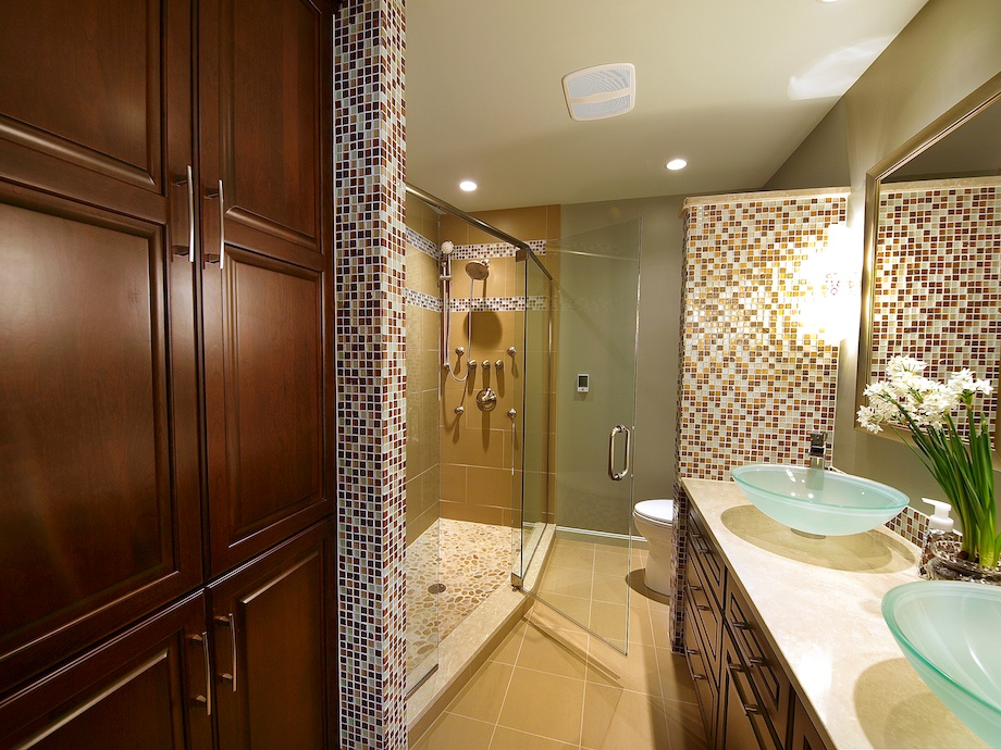 Client's Request: Gut It and Make It Glorious - The clients wanted an extended walk-in shower, no tub.  We removed the top portion of the wall by the sink for a more open feel.  Removing the tub made room for this linen closet, which inclues a pull-out laundry basket.  Notice how the large tiles on floor are repeated on the shower walls.