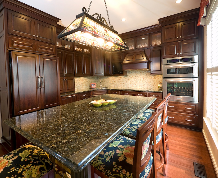 The granite countertops feature a plain edge on the perimeter and a routed edge on the island.