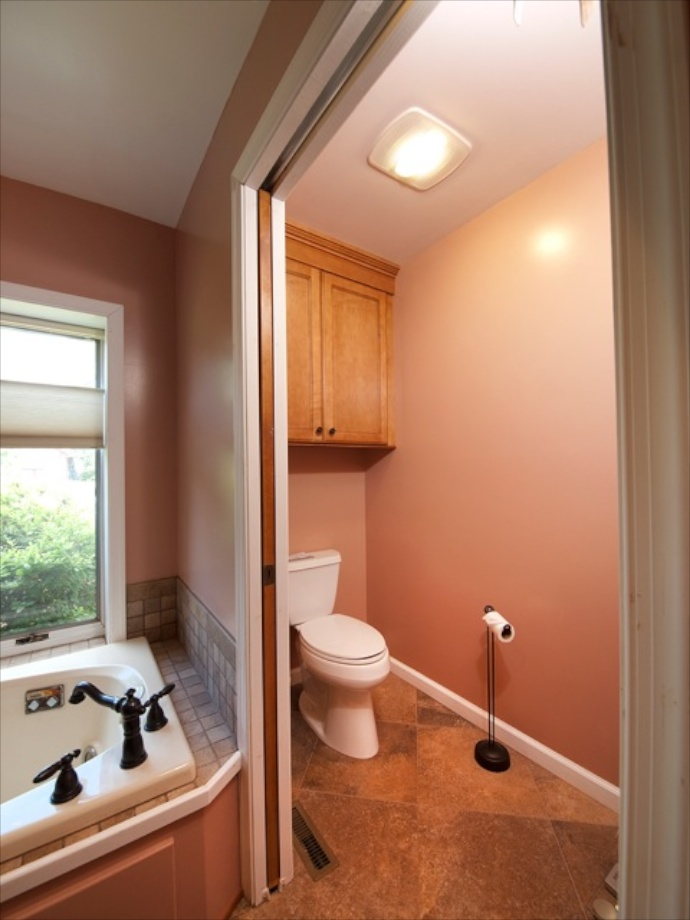 Pocket doors eliminate the need to allow space for door swing. We now have a private water closet where the walk-in shower once was.
