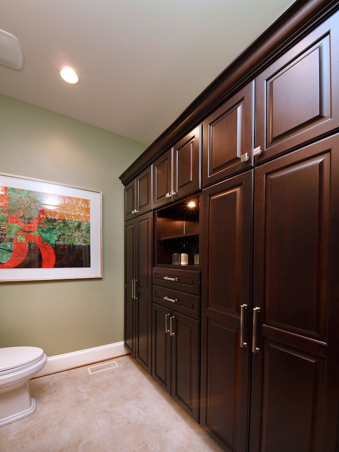 A bank of storage incorporates drawers, shelves, closets, and cupboards for maximum flexibility.