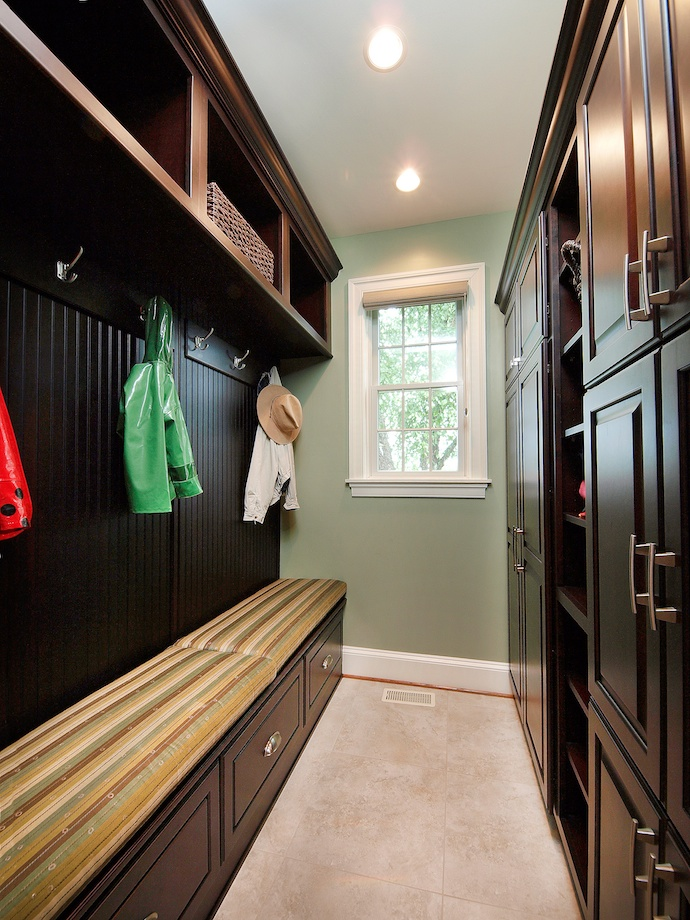 In this mudroom, storage options abound: cubbies, open shelves, closed cabinets and closets, drawers, and hooks.