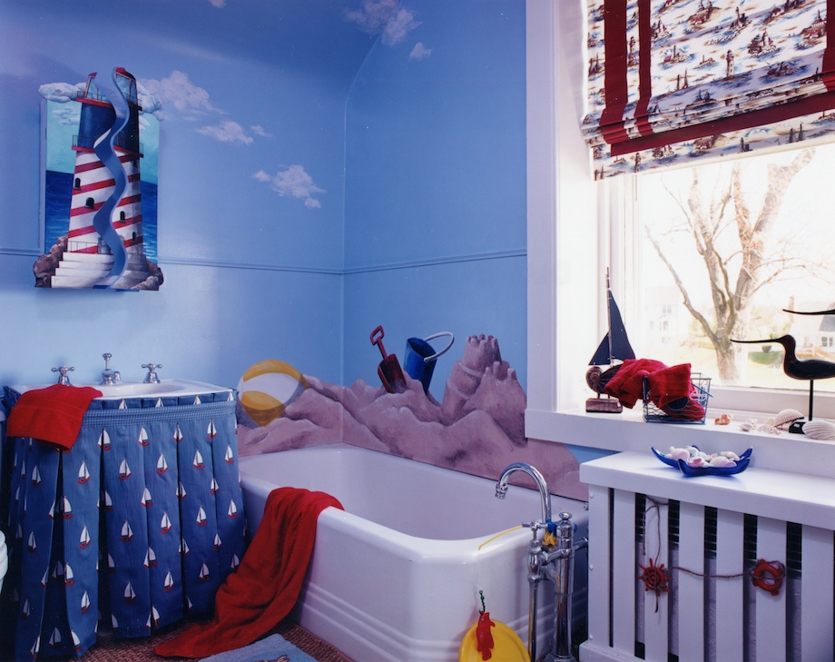 What boy wouldn't enjoy a beach mural in his bathroom? Nautical accessories on the windowsill and radiator cover enhance the seaside theme. Painted wooden shutters transform the bathroom cabinet. This bath project along with the bedroom was featured in several design publications.